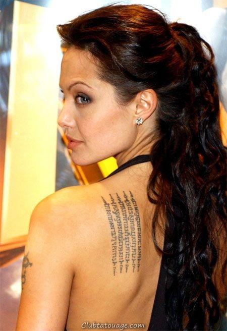 angelina jolie dos, on voit leurs tatouages thai
