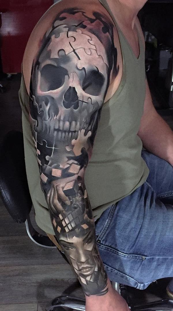 crâne avec manche de puzzle tatouage-4